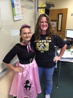 a teacher with her student dressed up in a poodle skirt for spirit week
