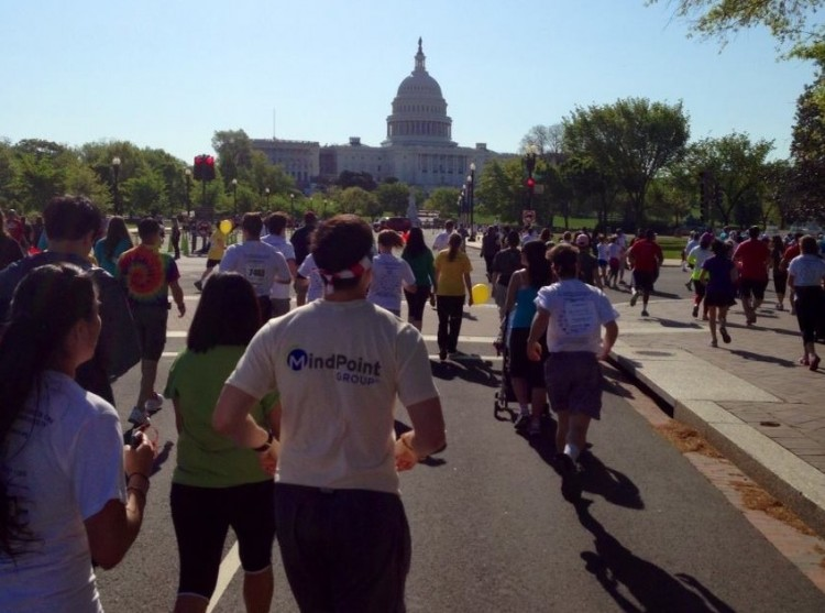 group of people running towards us capitol building