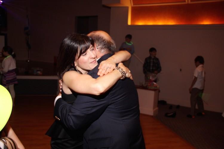 Deborah hugging her father