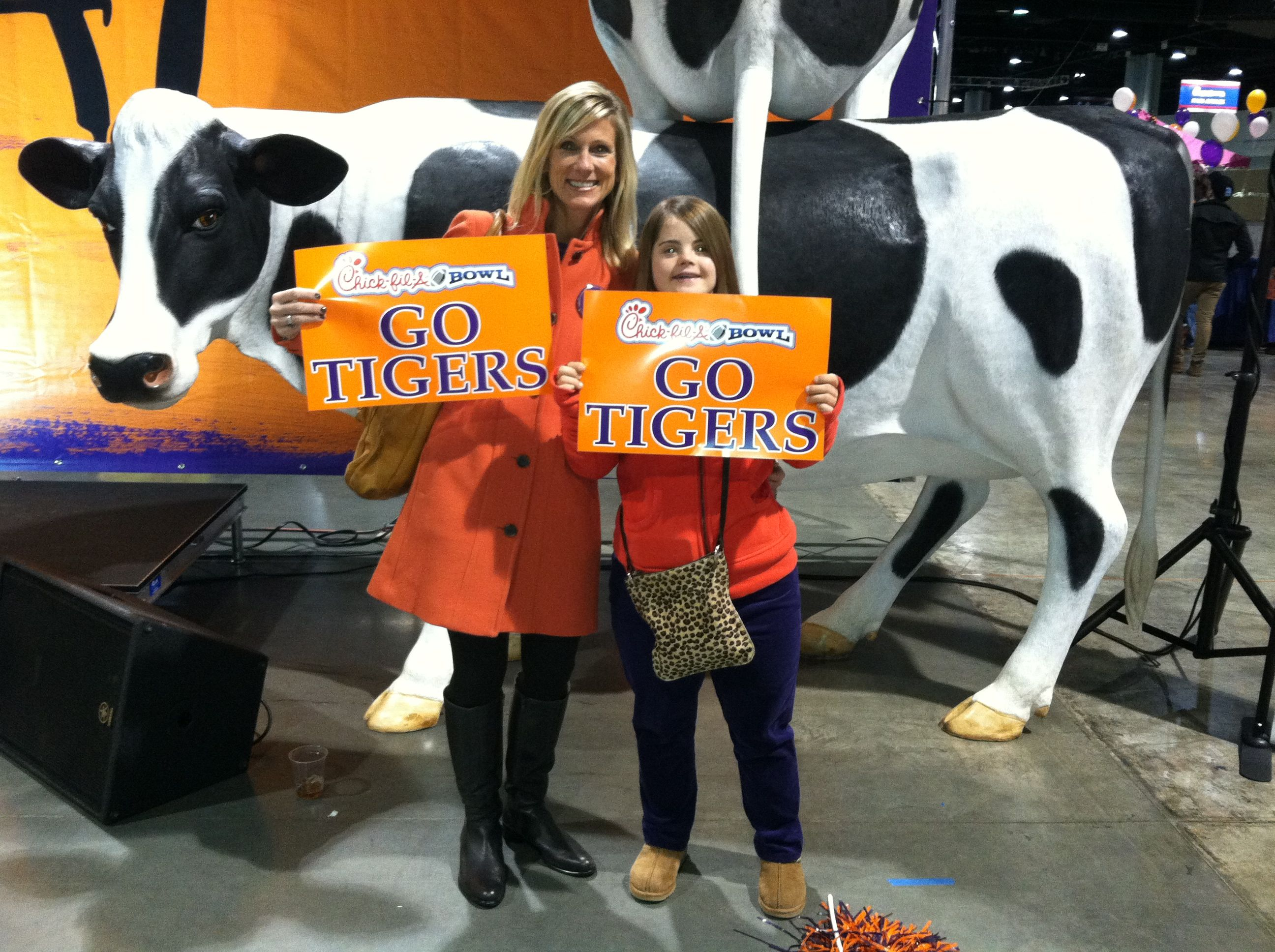 Hope and her mom at a Clemson Bowl football game.