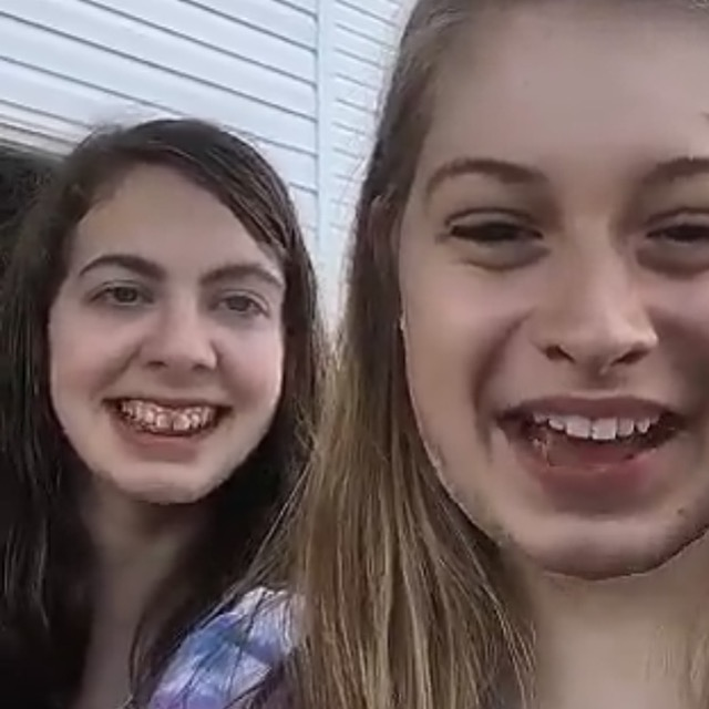 two teenage girl friends smiling