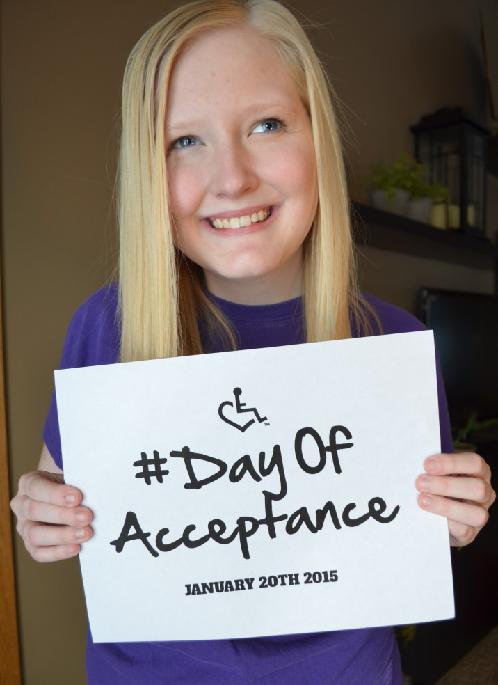 author holding sign that says day of acceptance