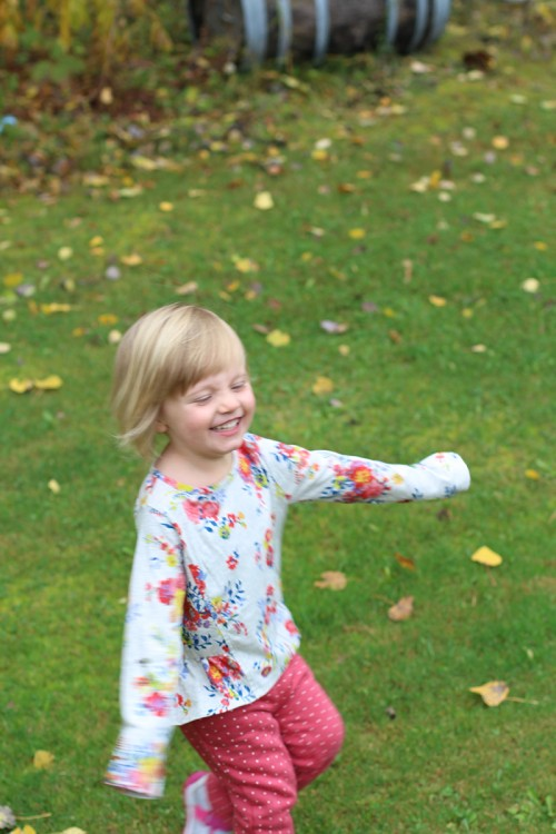 Isla, little girl with blonde hair playing outside