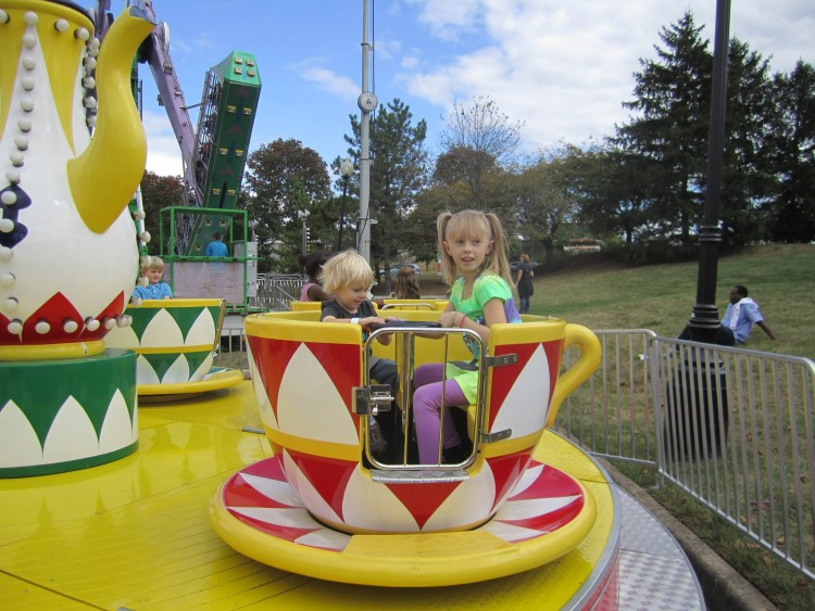 Kathy's son and daughter riding tea cups at the fair