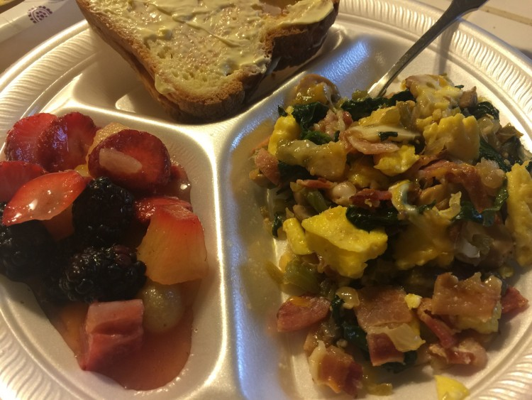 plate divided into three sections of fruit, eggs and toast