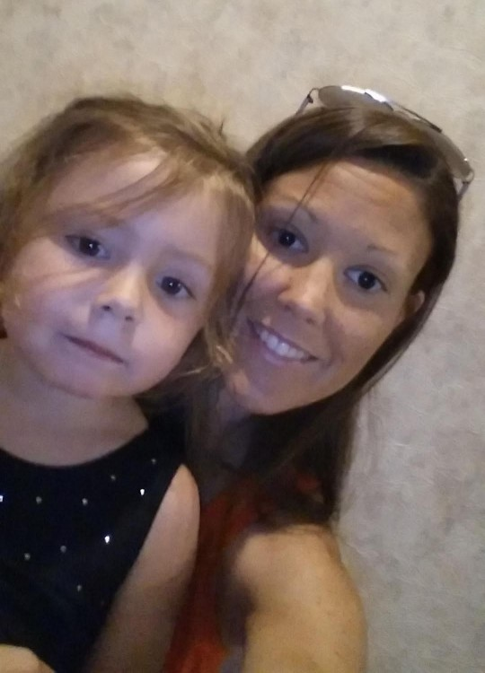 selfie photo of a young girl and her mom