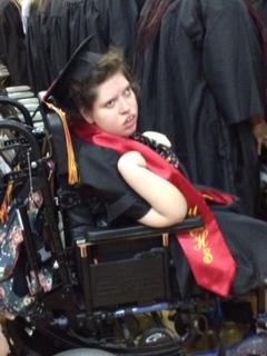 girl in wheelchair attending graduation ceremony