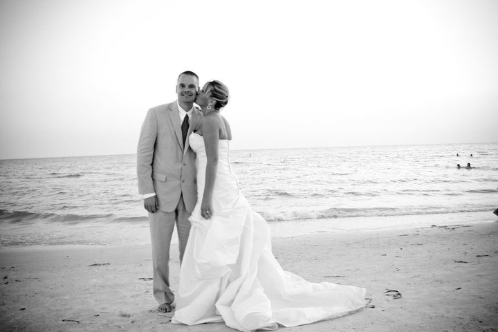 black and white photo of a wedding couple on the beach