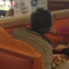 A waiter feeds a man with no hands at the Cinco de Mayo Mexican Restaurant in Georgia.