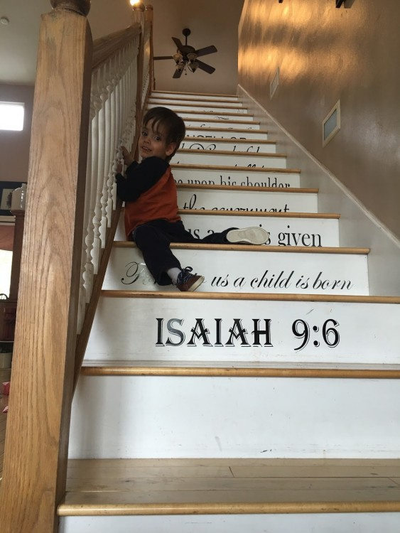 Israel climbing the stairs.