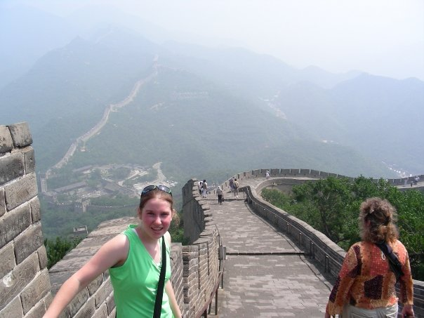 girl on the great wall of china wearing a green shirt