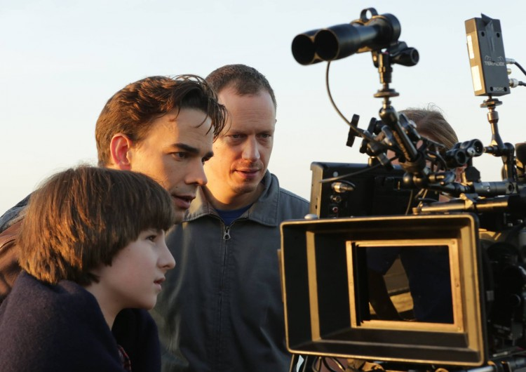 "Actors Julian Feder and Christopher Gorham and director/producer John Asher on the set of ""Po."""