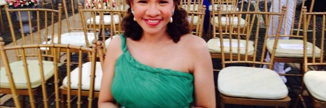 Maja smiling in a formal dress