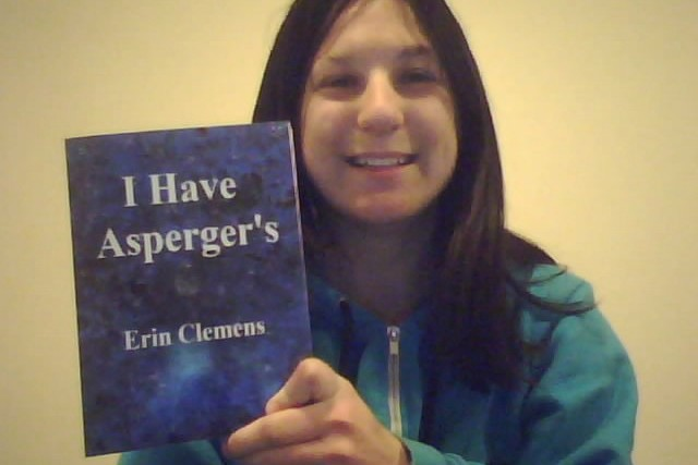 Erin with her book, 'I Have Asperger's'