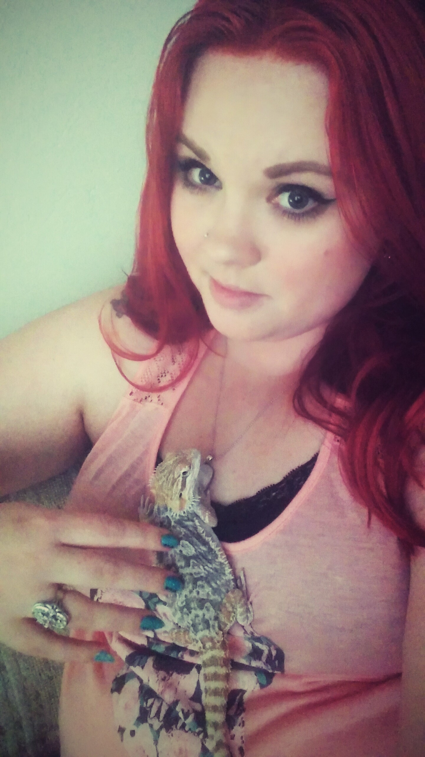 Woman holding her pet bearded dragon