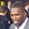 rapper 50 cent giving an interview at an event