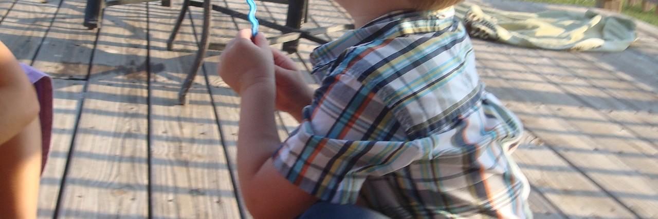 susanne's son blowing bubbles