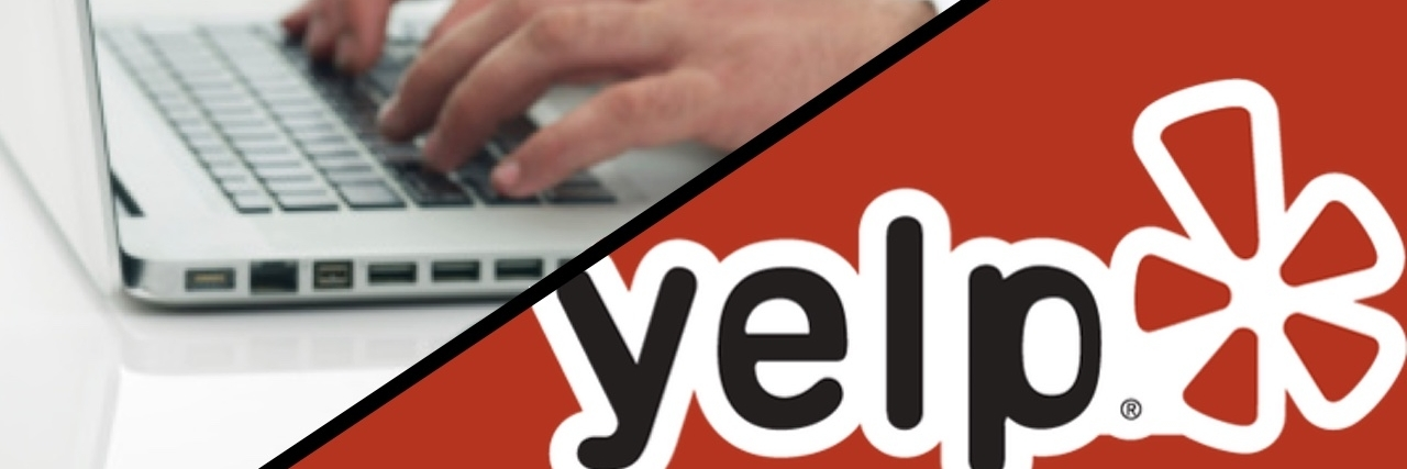 Doctor working on his notebook plus yelp logo