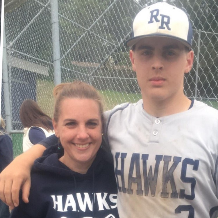 Erin with her son at a baseball game