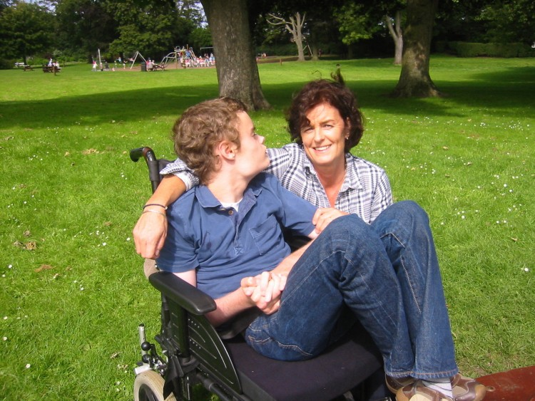 Philippa and her son in a park.