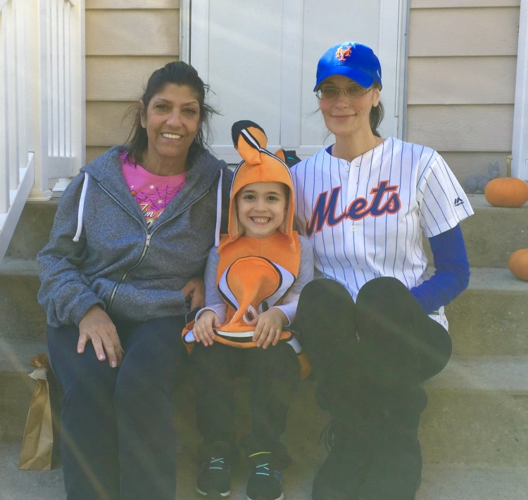 Nicole's mother, her son, and Nicole in a baseball cap.