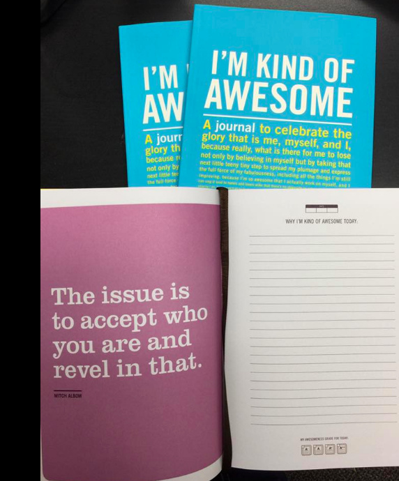 "A photo of the I'm Kind of Awesome journal with a copy opened to a page that says, ""The issue is to accept you who are and revel in that"""