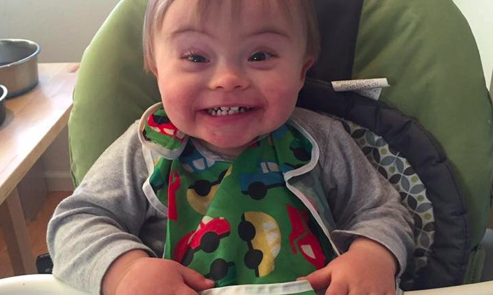 The author's son in a high chair, smiling