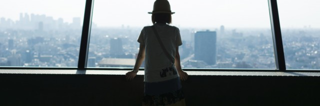 Woman watching Tokyo cityscape from high rise