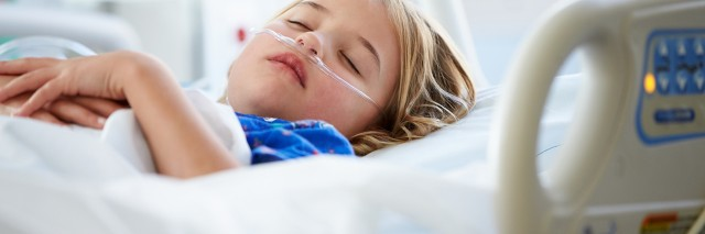 Peaceful And Relaxed Young Girl Sleeping In Intensive Care Unit