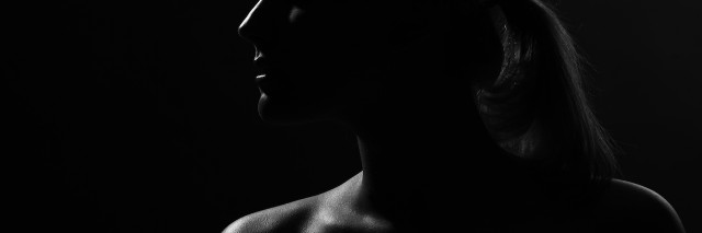 young woman in the dark