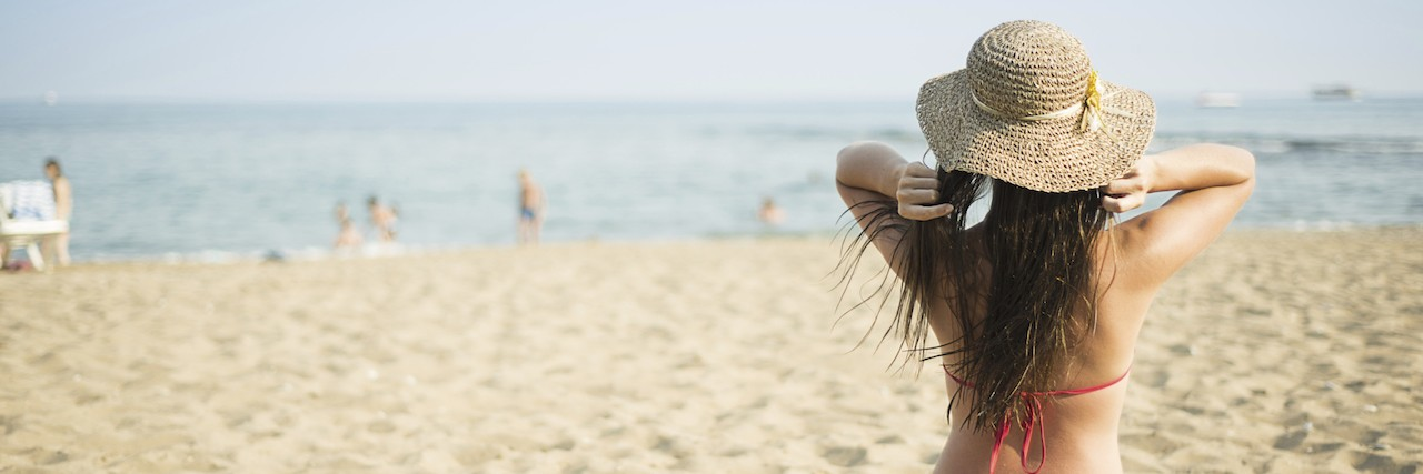Woman on the summer beach