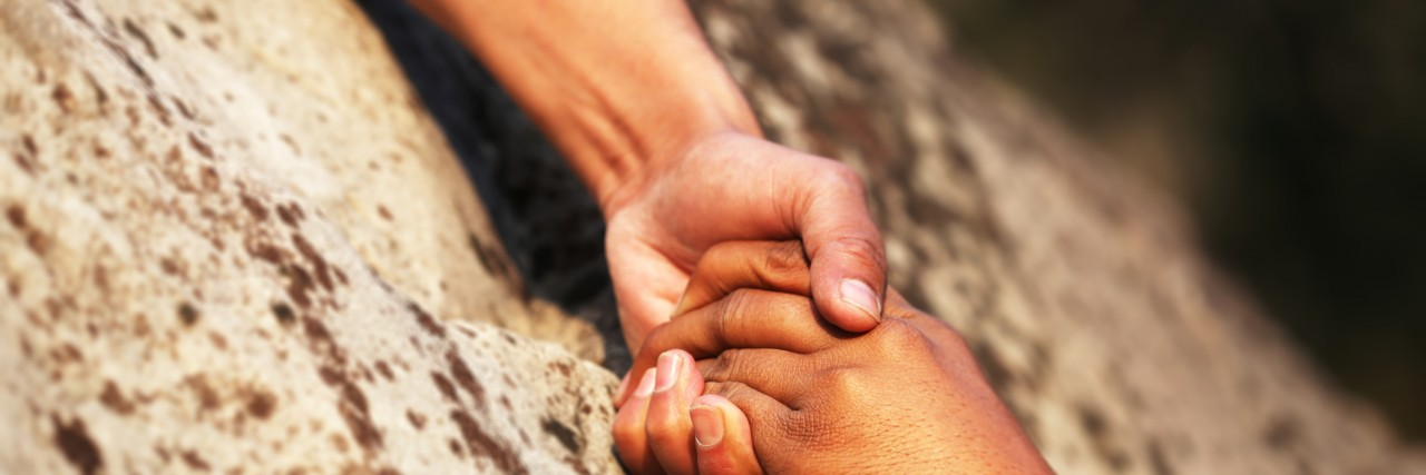 Hand holding.