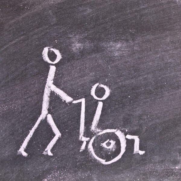 chalk sketch of person in wheelchair