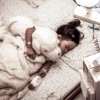 Sick little girl sleeping in the hospital