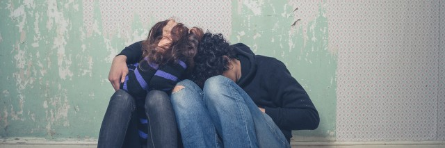Sad young couple on floor