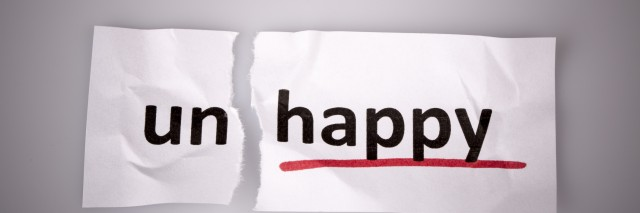 The word unhappy changed to happy on torn paper and white background
