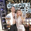 "Nyle DiMarco and pro dance partner Peta Murgatroyd pose with the ""Dancing with the Stars"" mirror ball trophy."