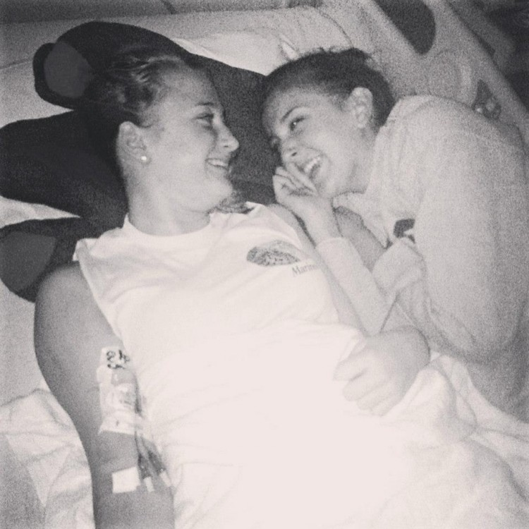 two women lying on a hospital bed in black and white photo