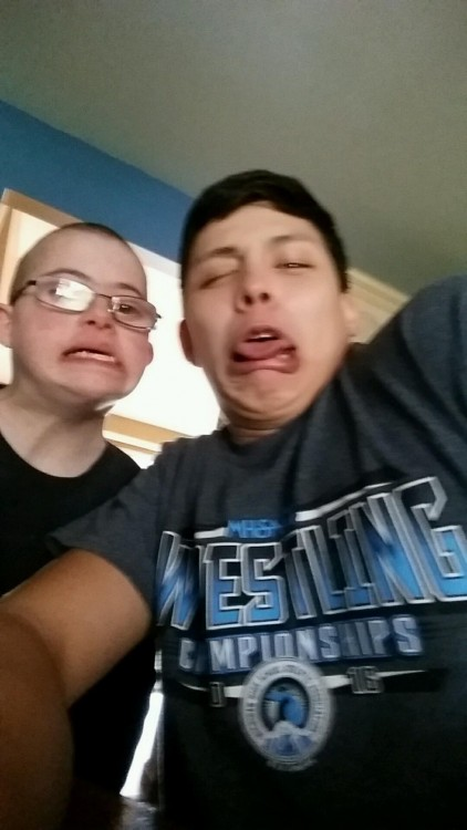 two young boys taking a funny selfie