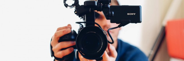 photographer pointing camera