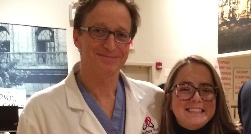 young woman standing with her doctor