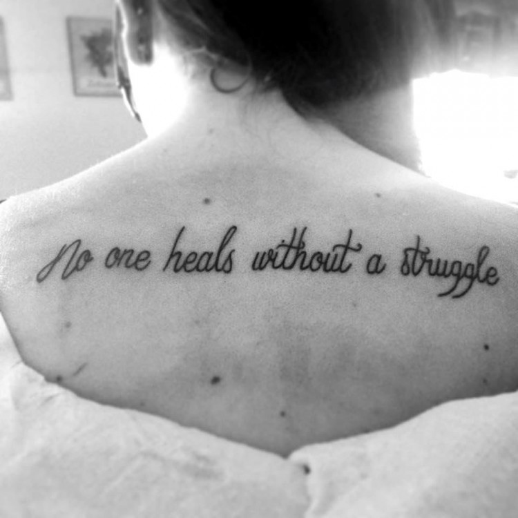 Tattoo reads: No one heals without a struggle.