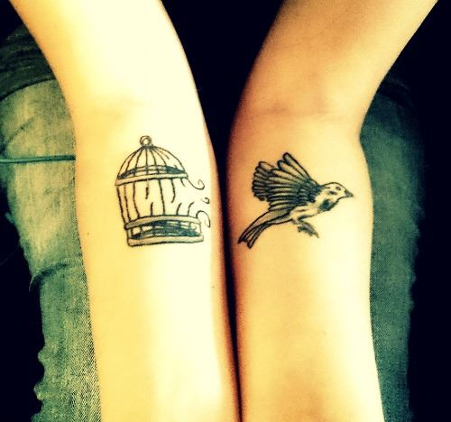 Tattoo of bird jumping out of its cage.