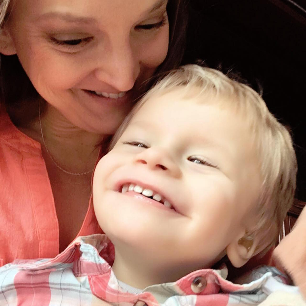 mom and her son christopher smiling