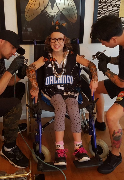 Girl in wheelchair gets tattooed