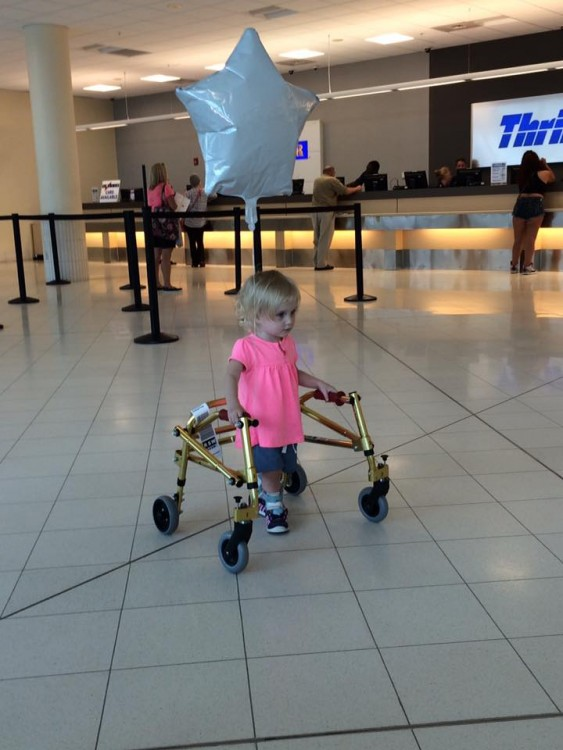 toddler using walker at airport
