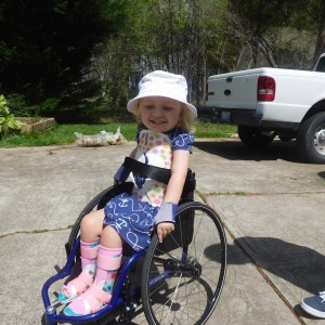 Heidi in her wheelchair smiling