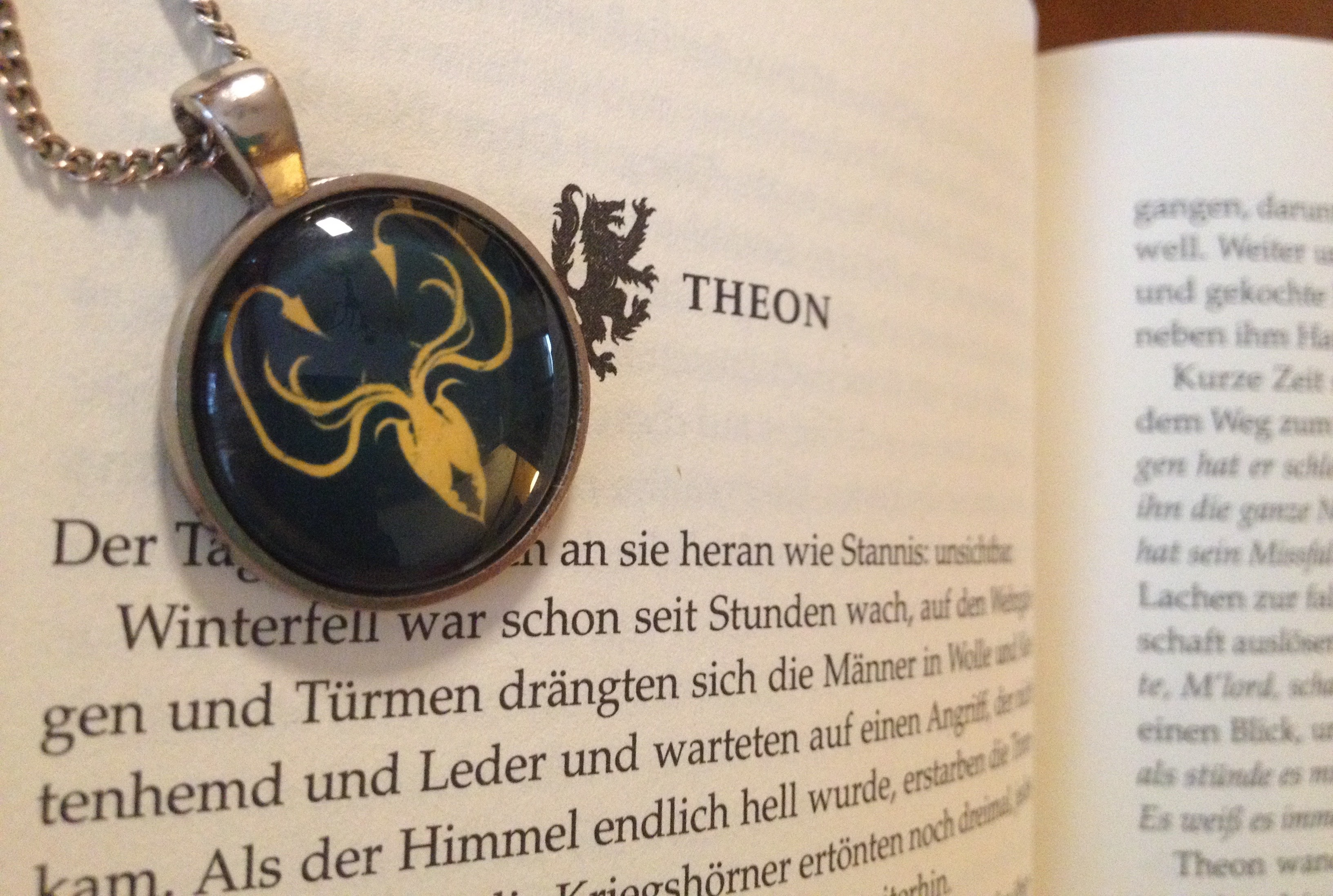game of thrones book with locket over it