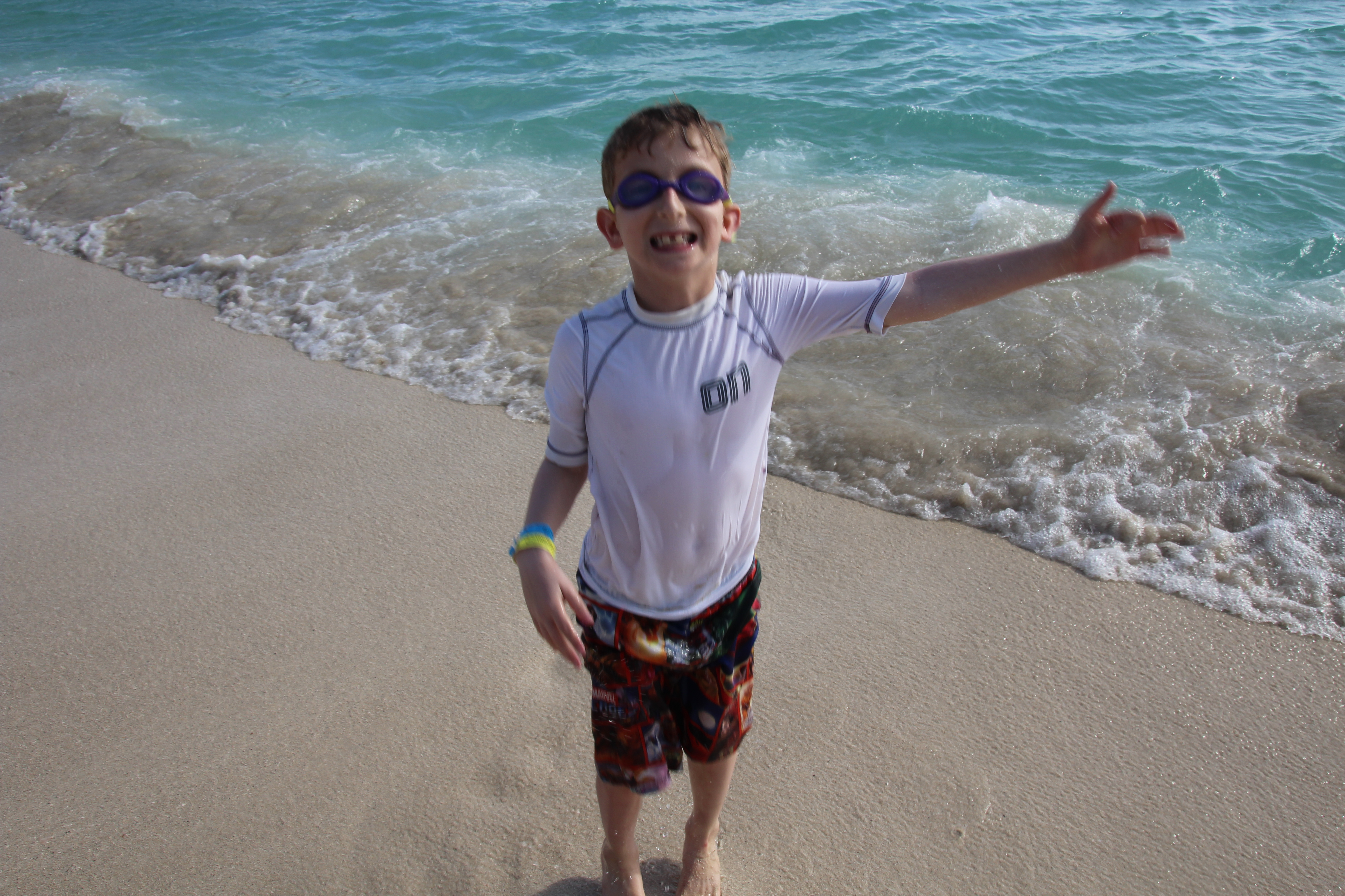 The author's son on the beach next to the shore