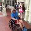 woman sitting in wheelchair at disney world